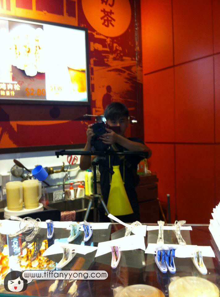 Director Lun filming from inside the store