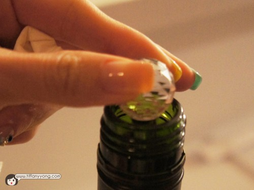 Placing the wand into the bottle of wine and perfecting it within minutes!